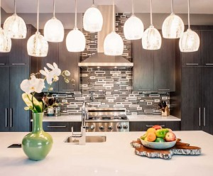 Contemporary kitchen with graphic tiles and custom blown glass pendants by Obelisk Home