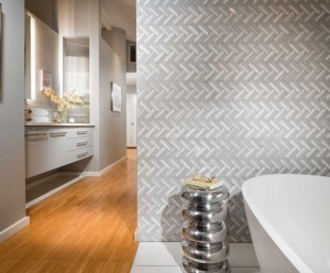 Master bathroom with unique tile pattern and stand alone bathtub
