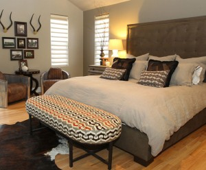 Master bedroom with geometric bench and suede headboard by Obelisk Home