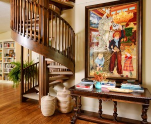 Foyer with winding staircase and original art by Karen Schneider, design by Obelisk Home