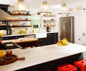 Modern farmhouse kitchen with open shelving, subway tile and red stools by Obelisk Home