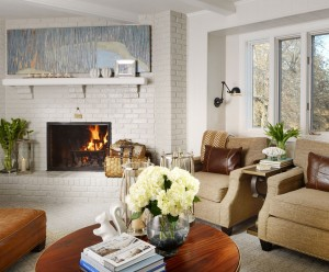 Cozy traditional family room with a pair of matching chairs and original art by Kat Allie