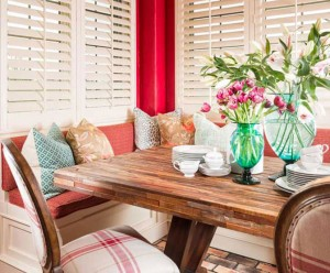 Breakfast nook with bench seating and wood block table by Obelisk Home