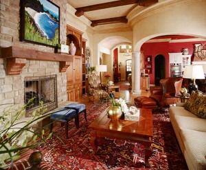 Traditional living room with red accents and original artwork by Jared Gillett, design by Obelisk Home