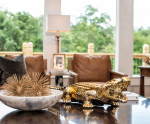 Contemporary house with brown leather chairs and gold alligator
