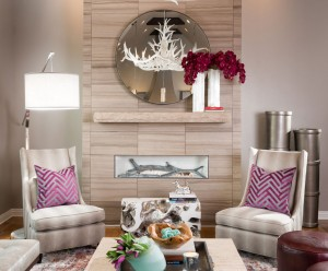 Modern sleek living room in a neutral color with pops of plum
